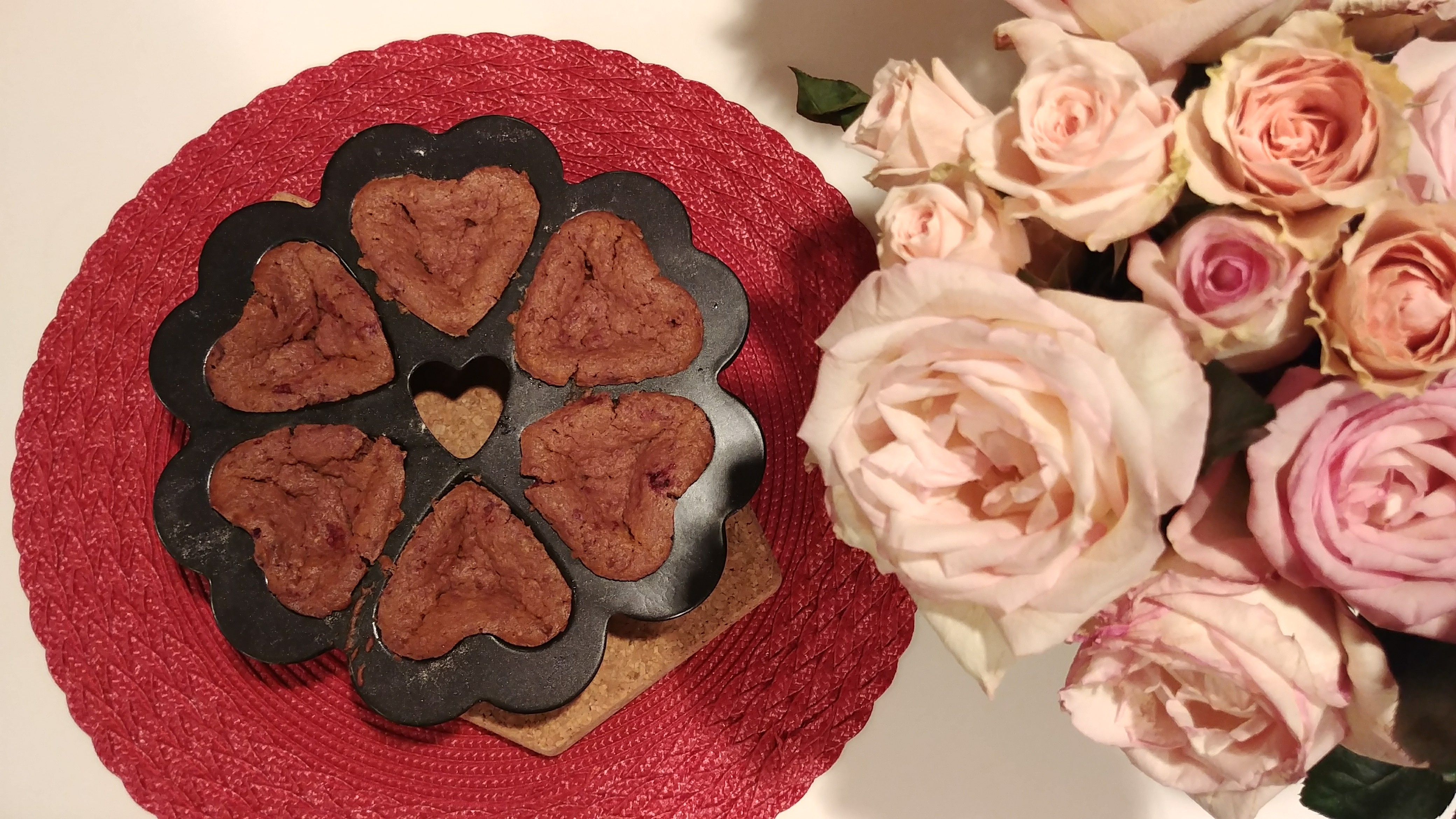 6 Cakelets in a Specialty Heart Pan with Roses on table